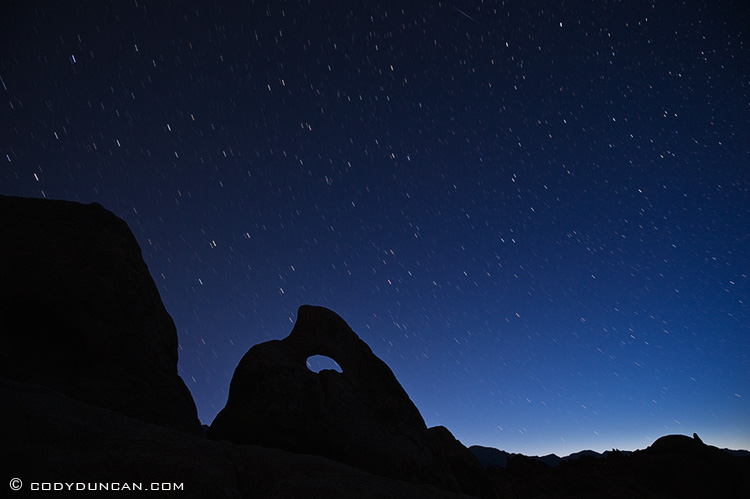 NIght photography Nikon d700: star trails over rock formations, Alabama Hills, California