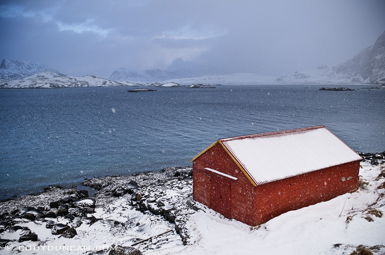 Travel landscape stock photography: boat shed in winter snow storm, Selfjorden, Lofoten islands, Norway