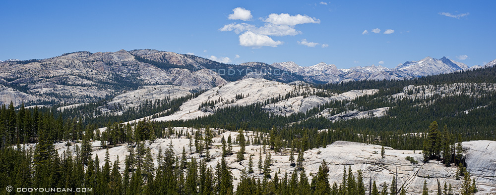 Panoramic landscape photo of granite mountains of Yosemite high country, California