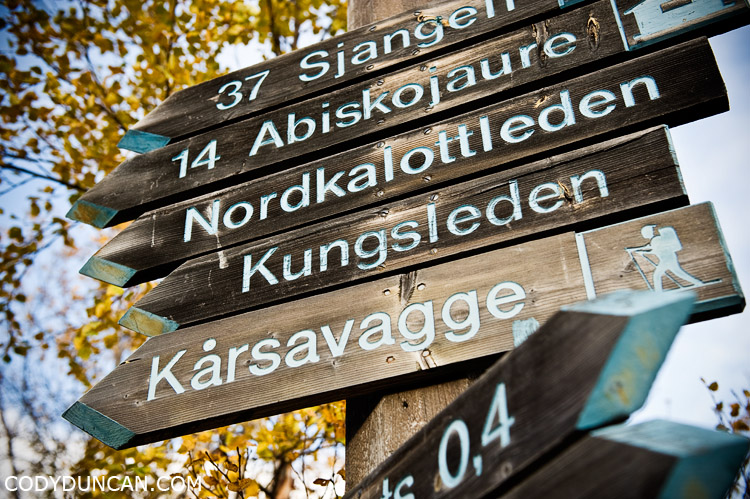 Kungsleden sweden travel photography: route and distance signs at start of trail in Abisko