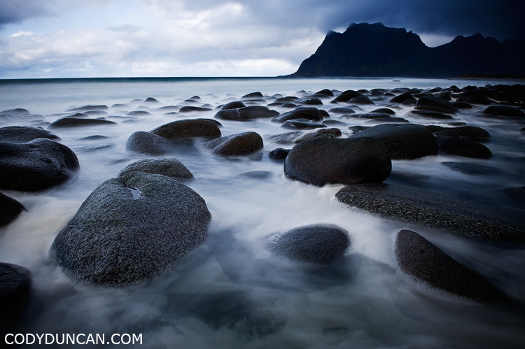 Lofoten islands Norway travel photography: rocky beach at Utakleiv in storm