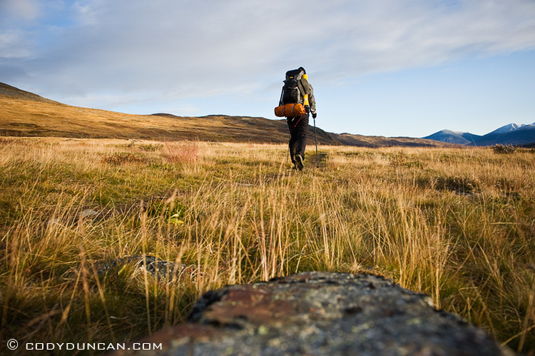 Outdoor lifestyle photo - Solo hiker on Kungsleden trail, Lapland, Sweden