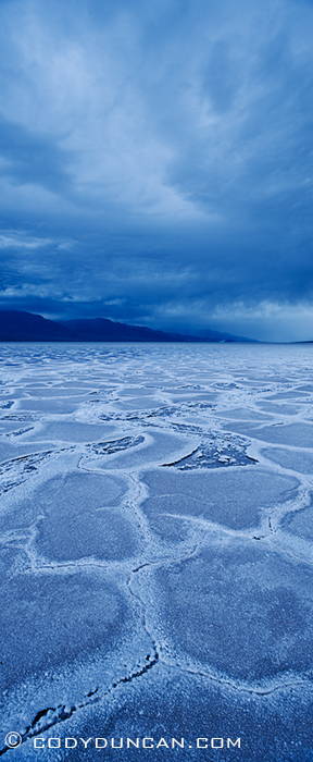 panoramic landscape photography - Rainclouds over Badwater Basin, Death Valley, California. February 27, 2010
