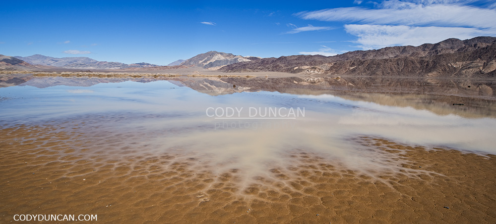 rare winter water fill dry lakebed of devils racetrack playa - death valley, california