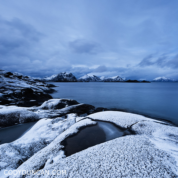 Travel stock photo: Snow covered rocky coastline at Stamsund, Vestvågøy, Lofoten islands, Norway