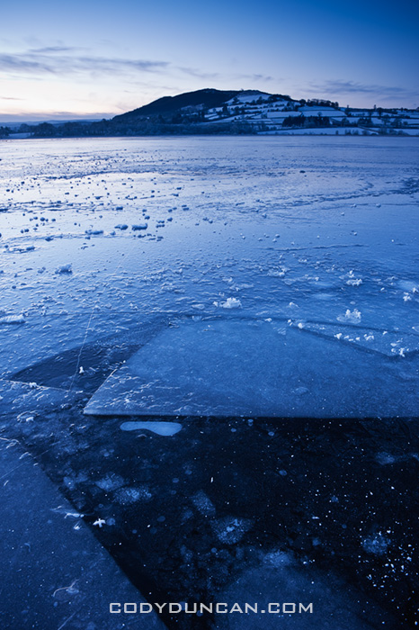 Ice covers Llangorse lake at dawn, Brecon Beacons naitonal park, Wales