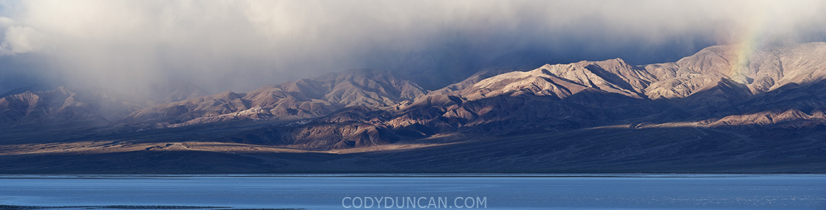 Winter rain clouds over Badwater and mountains, Death Valley national park, California