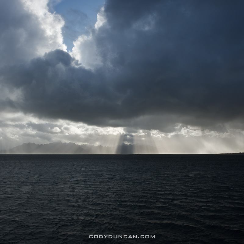 Dramatic light over mountains of vesteralen as viewed from Hurtigruten