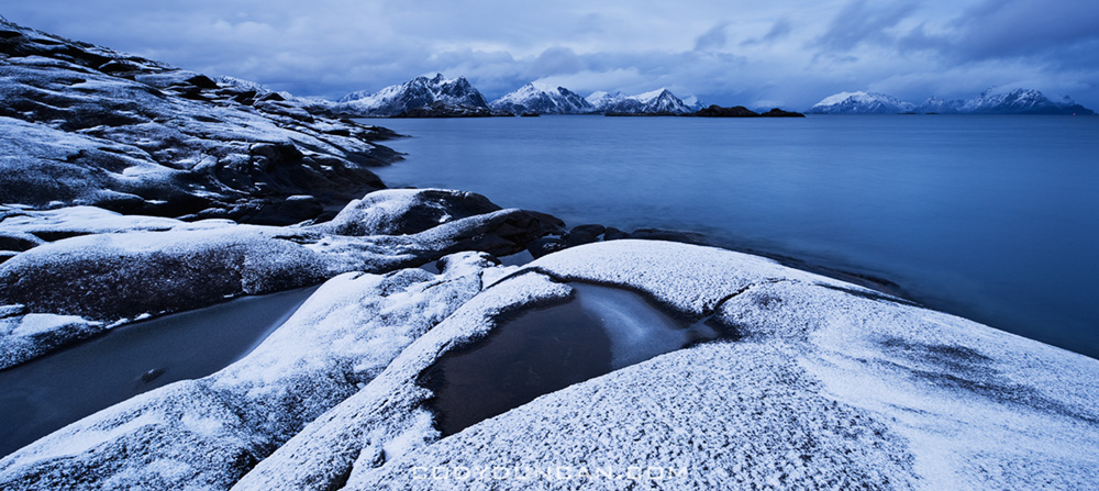 Snow covered rocky coastline at Stamsund, Vestvagoy, Lofoten islands, Norway