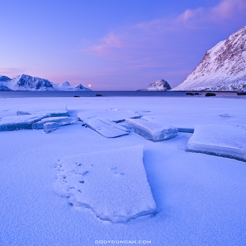 Ice on Haukland beach in winter, Lofoten islands, Norway