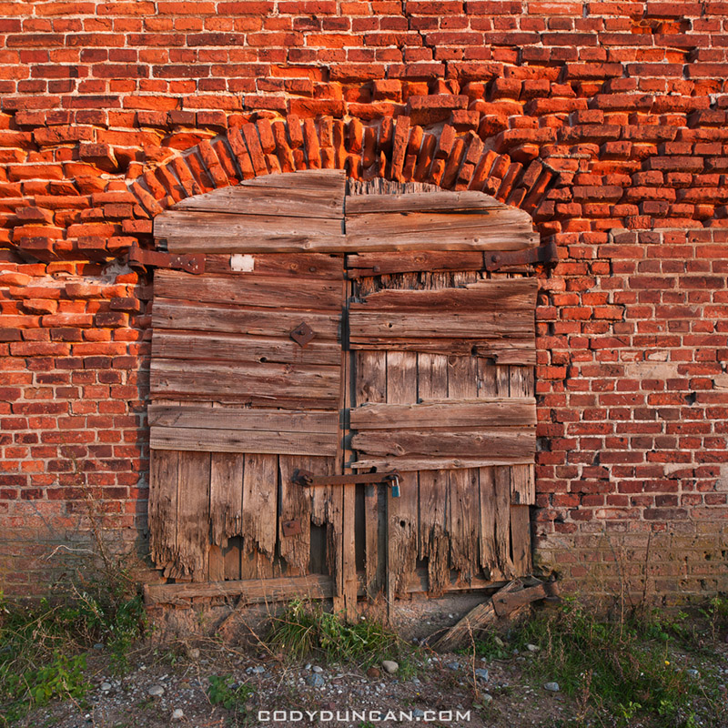 Old brick building and wooden door, Klaipeda, Lithuania