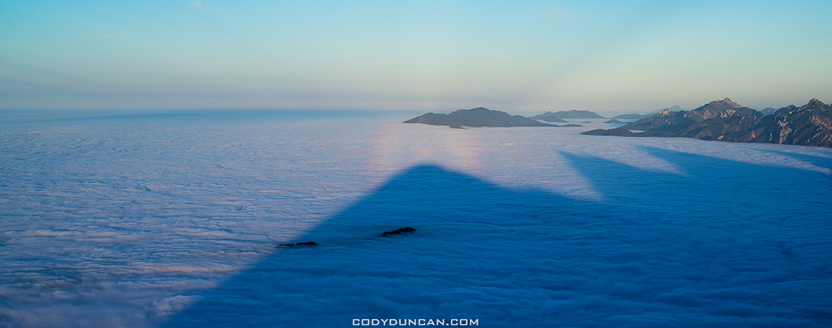 mountain shadows on inversion layer fog, from summit of Breitenberg, Allgäu, Germany