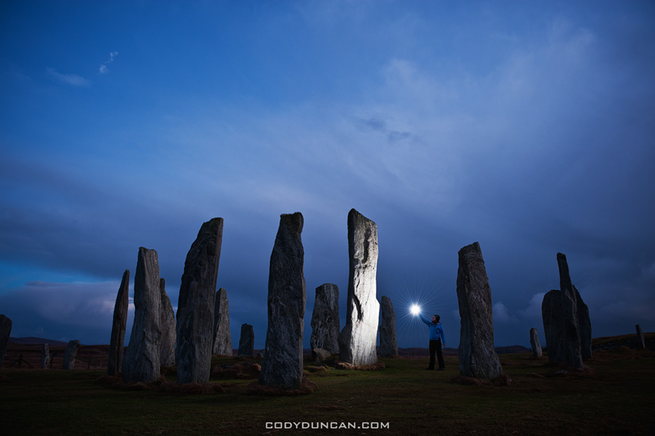 Callanish standing stones lit by light at night, Isle of Lewis, Western Isles, Scotland