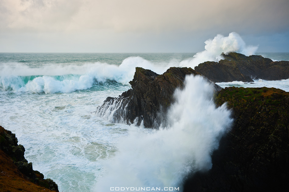 Large winter waves crash against cliffs at Butt of Lewis, Isle of Lewis, Outer Hebrides, Scotland