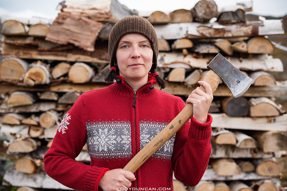 holding axe to cut firewood at mountain hut, Kungsleden trail, Lappland, Sweden
