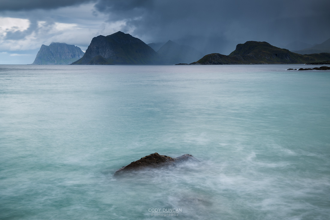 Storsandnessanden beach looking towards mountains of Vestvagoy, Lofoten Islands, Norway