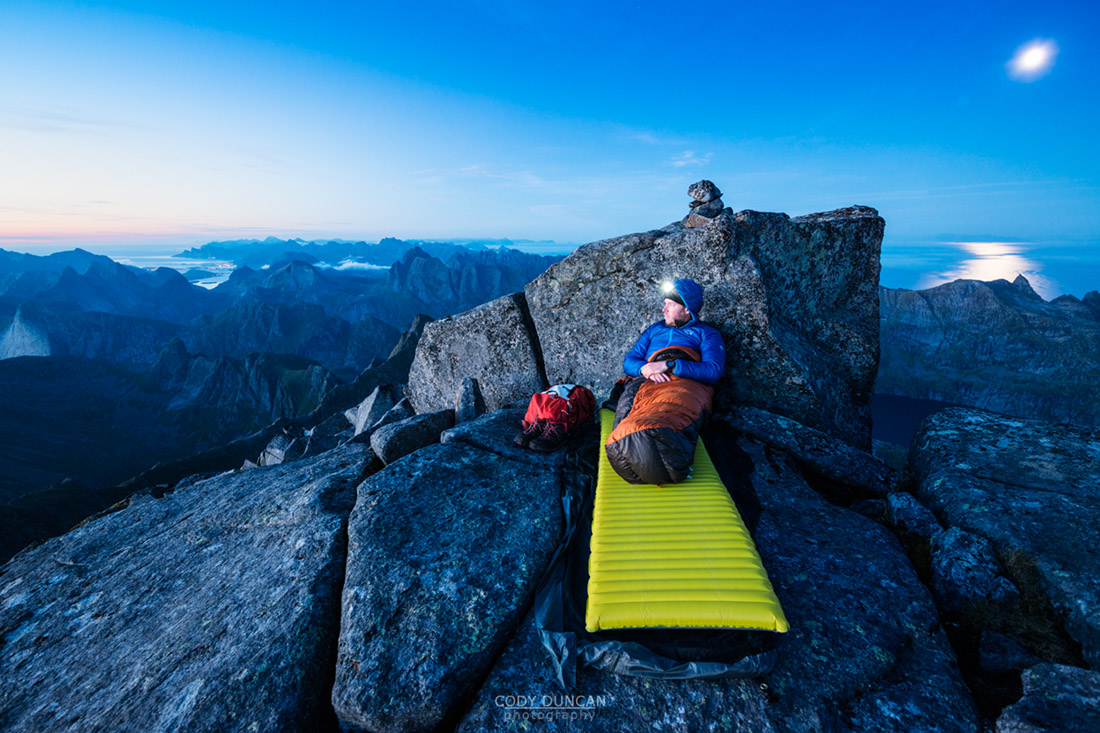 mountain bivy on rocky summit of Hermannsdalstinden, Moskenesoy, Lofoten Islands, Norway