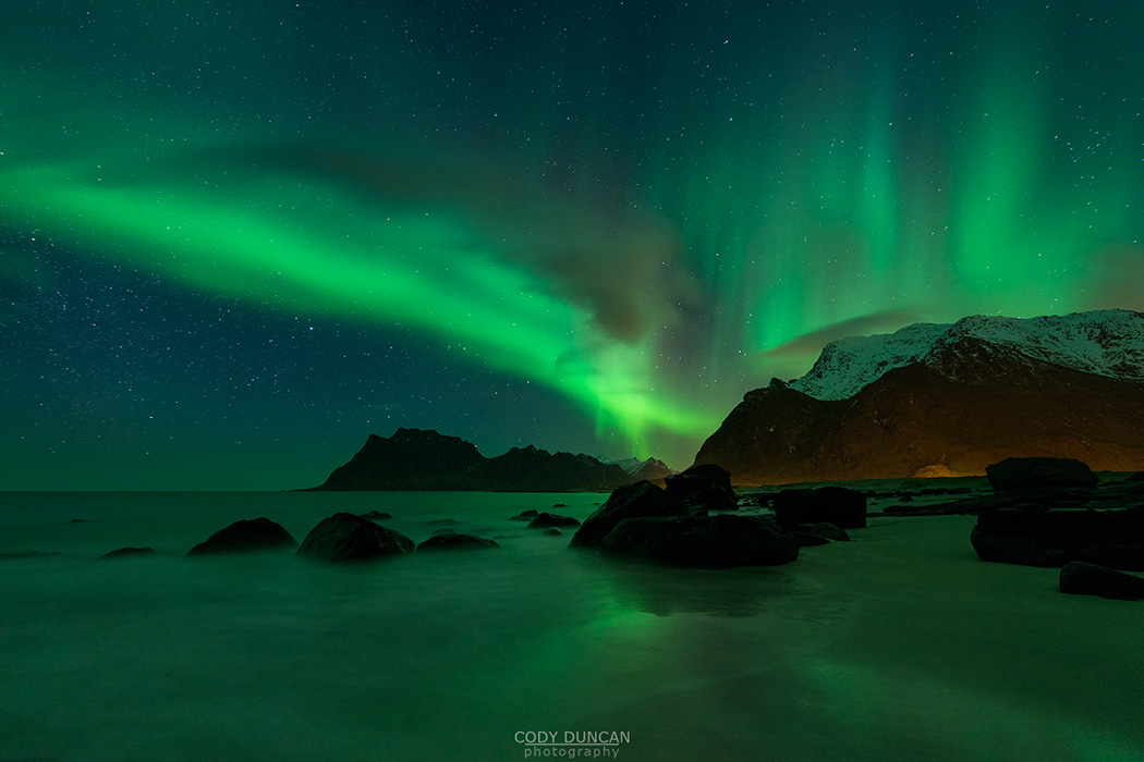 Northern Lights - Aurora Borealis shine in Sky over Uttakleiv beach, Vestvågøy, Lofoten Islands, Norway