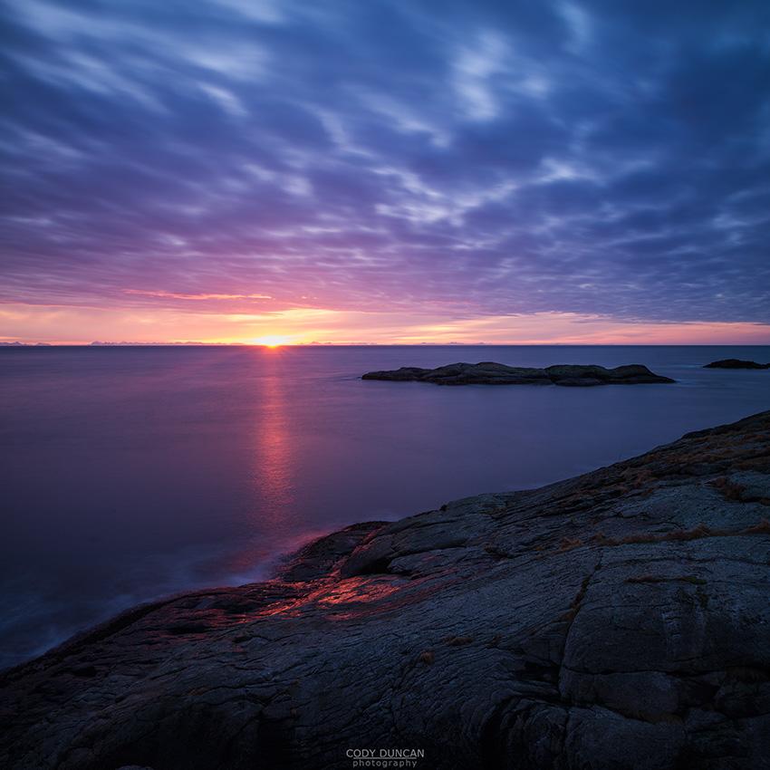 Winter sunrise over Vestfjord from Toppøya, near Reine, Moskenesøy, Lofoten Islands, Norway