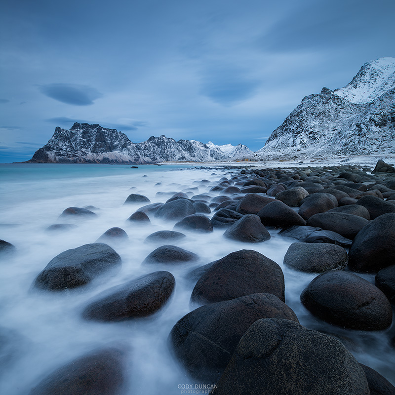 Waves wash over coastal rocks at Uttakleiv beach, Vestvågøy, Lofoten Islands, Norway