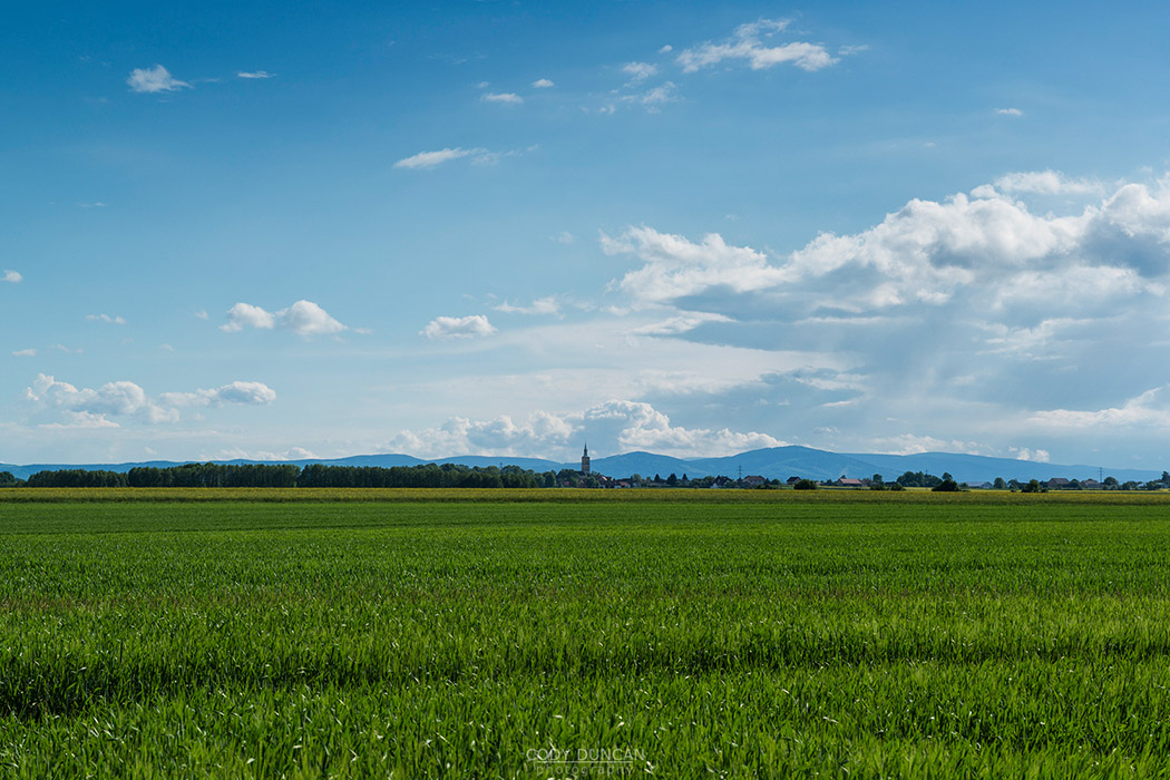 View over spring farm fields towards village of Scmicz - Schmitsch, Opole Voivodship, Poland