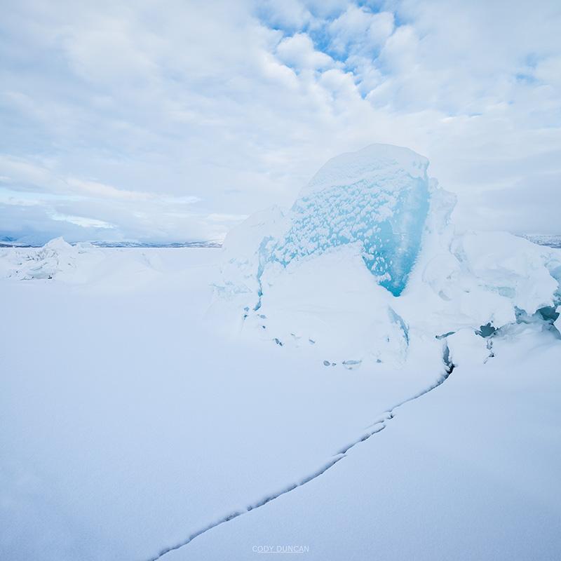 Ice rift on frozen lake Torneträsk in winter, Abisko national park, Lapland, Sweden