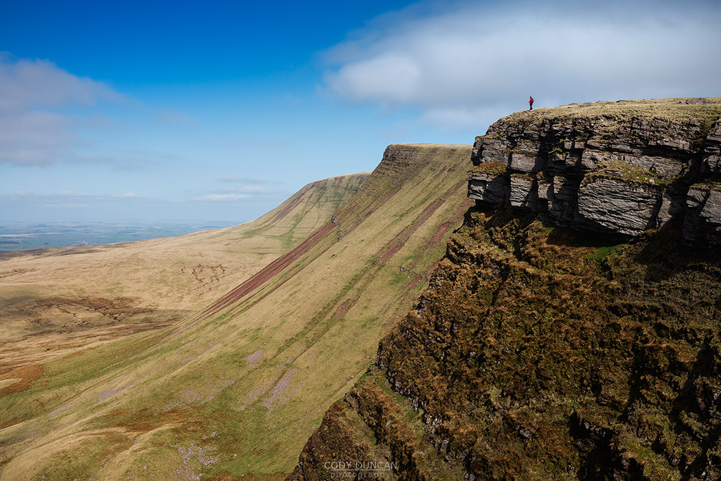 Female hill walker on Carmarthen Fans - Bannau Sir Gaer with Picws Du in distance, Black Mountain, Brecon Beacons national park, Wales