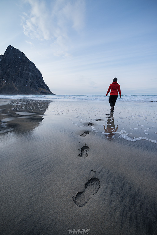 footpints in sand at scenic Kvalvika beach, Moskenesøy, Lofoten Islands, Norway