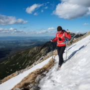 hiker crosses snow near summit of Koscielec (2155m), Tatra mountains, Poland