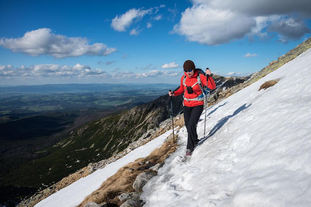 hiker crosses snow near summit of Koscielec (2155m), Tatra mountains, Poland