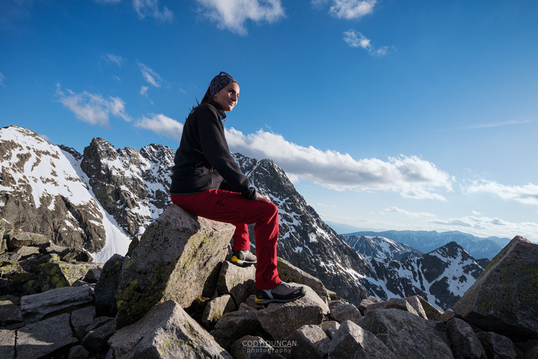 Female hiker on the summit of Koscielec (2155m), Tatra mountains, Poland