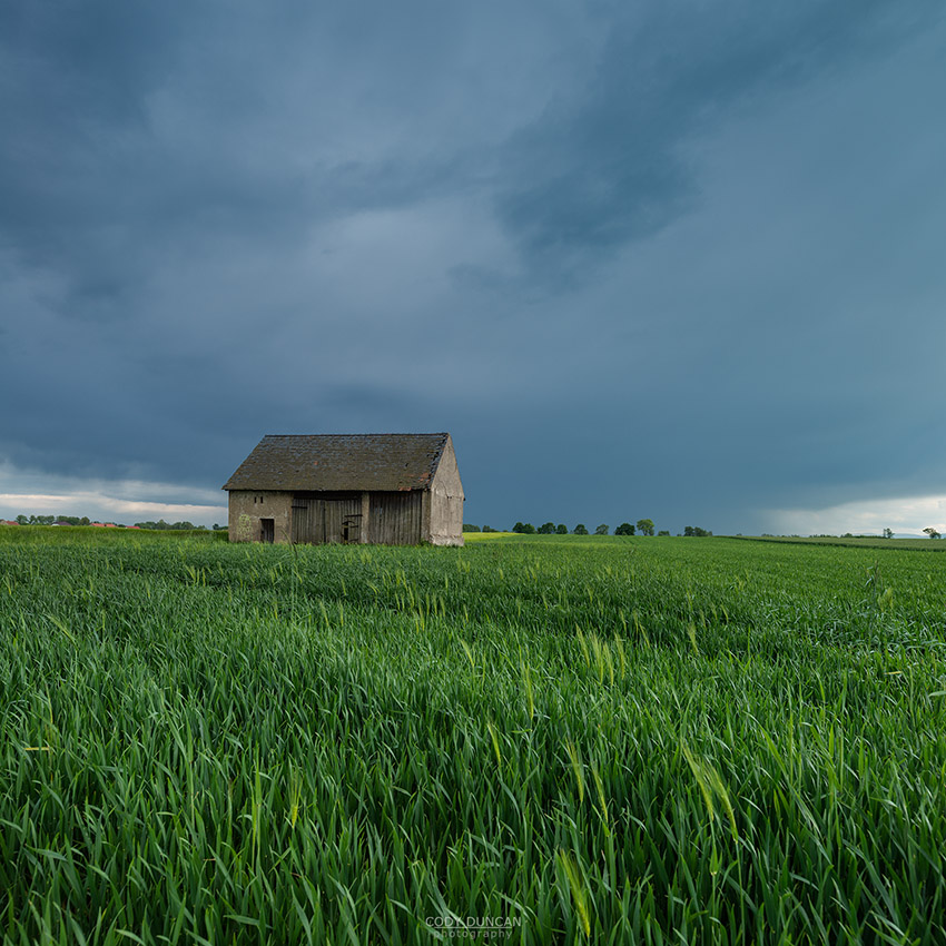 Old barn in farm field, Prudnik County, Opole Voivodship, Silesia, Poland