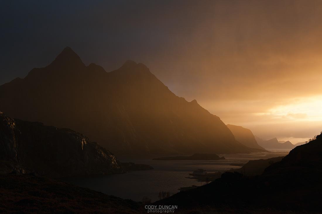 Dramatic light over mountains and coast, Maervoll, Lofoten islands, Norway