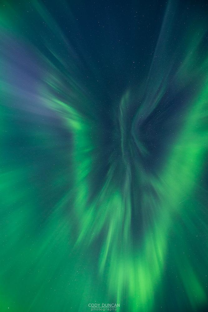 Aurora corona fills sky over Lofoten Islands, Norway